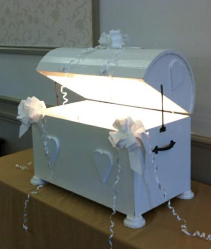 An image of a white wedding chest used to decorate a wedding venue