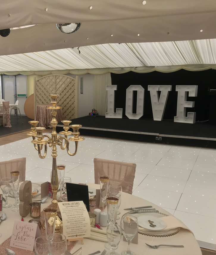 An image of a white LED dance floor, being used at a wedding which has been decorated by Solid State UK.