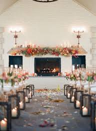 an image of a wedding isle with petals and candles