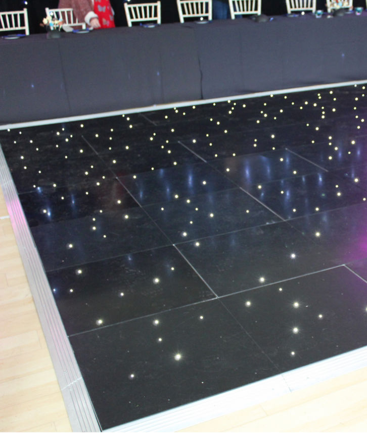 An image of a black dance floor which has been hired and installed by Solid State UK.