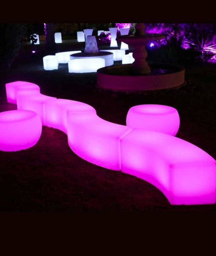 An image of LED chairs in pink and white that have been hired for a party from Solid State UK.