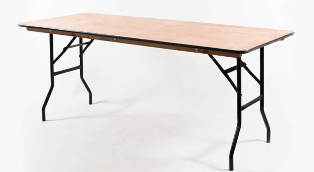 An image of a trestle table that can be hired for an array of functions by Solid State UK.