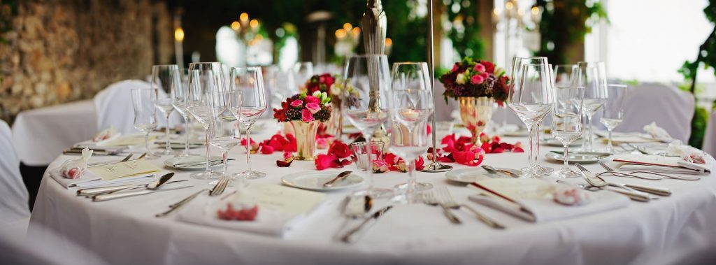 An image of a table set for dinner inside a marquee.