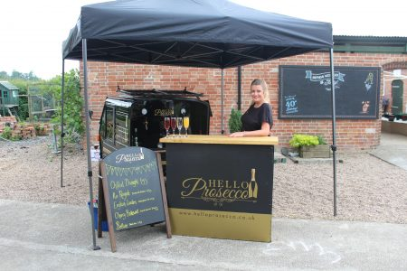 An image of a bar serving Prosecco at an event.
