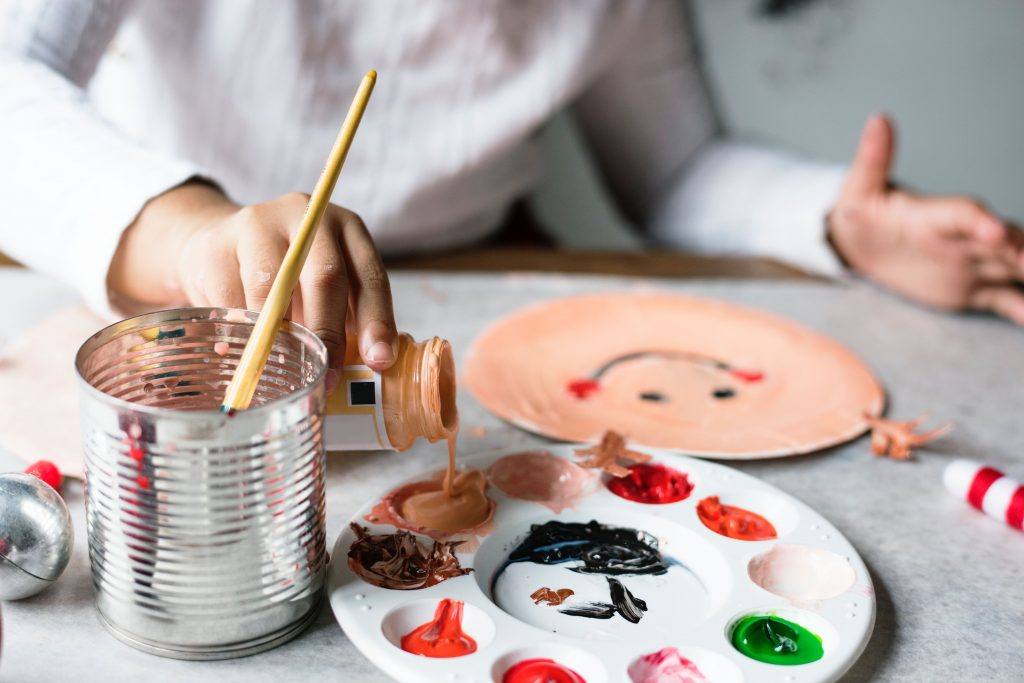 An image of a child painting at an arts workshop in Leicester.